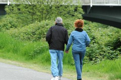 Couple walking for natural stress relief